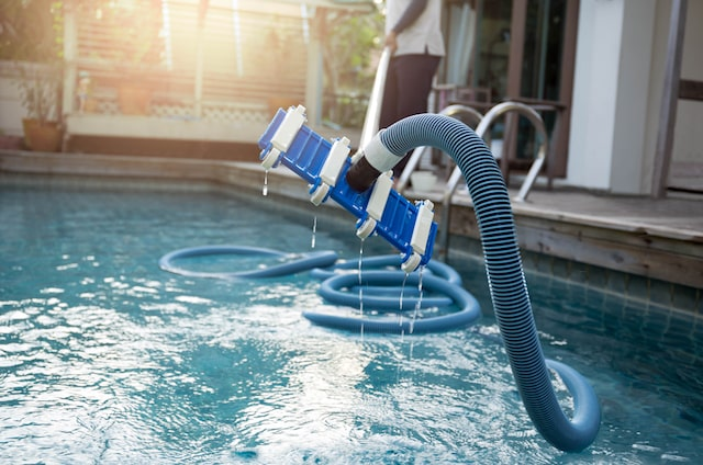 how to vacuum an above ground pool