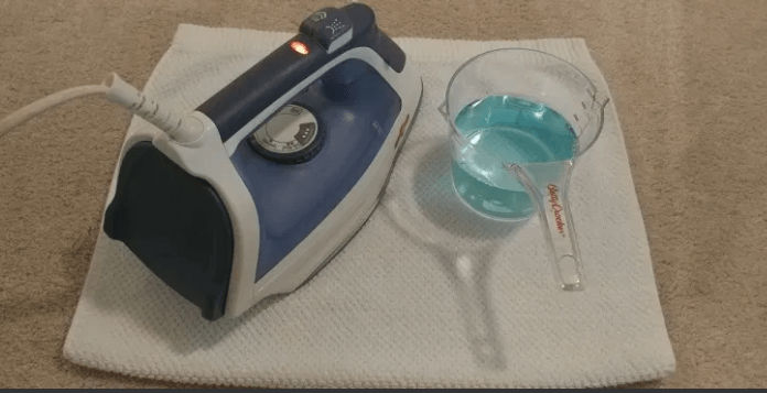 use steam iron for carpet cleaning
